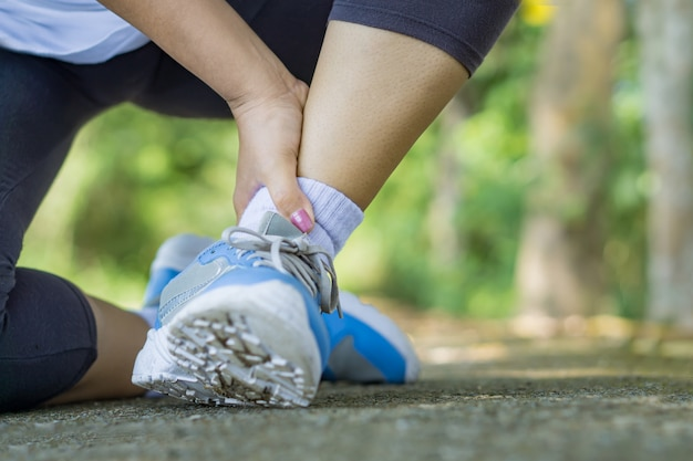 Female runner falling ,sport injury accident Premium Photo