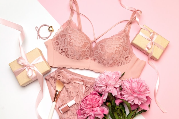 Female sexual pink lingerie on white Premium Photo