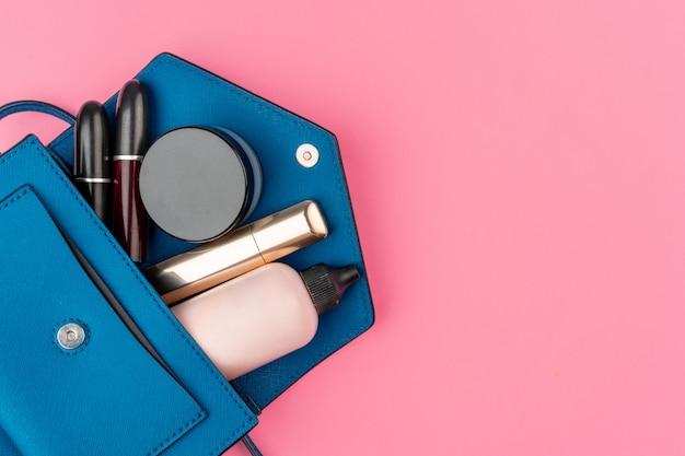 Female small handbag full of cosmetic products Premium Photo