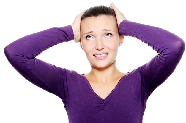 Самка сжимает голову от сильной головной боли Бесплатные Фотографии