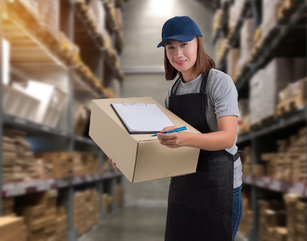 Female staff delivering products sign the signature on the product receipt form with parcel boxes Premium Photo