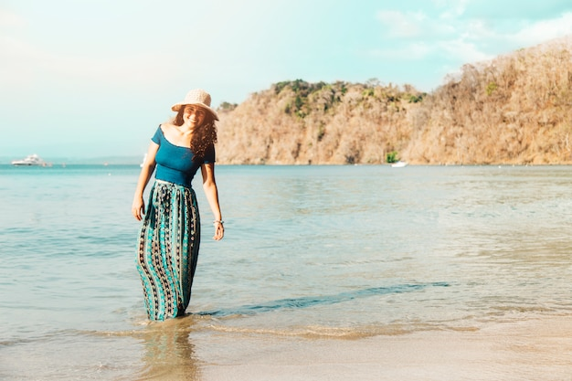 Female standing in water by seashore Free Photo