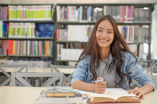 Female students are searching for research papers. Premium Photo