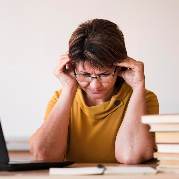 Female teacher with laptop close-up Free Photo