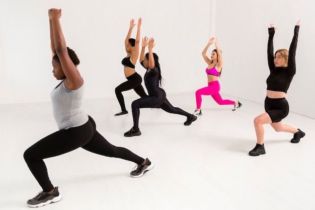 Female team work at fitness class Free Photo
