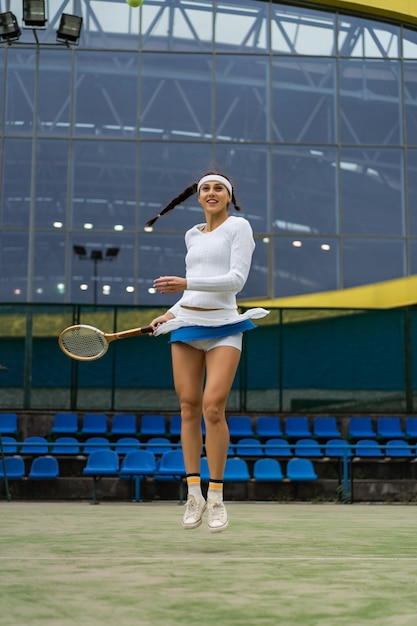 Female tennis player on green court grass Free Photo