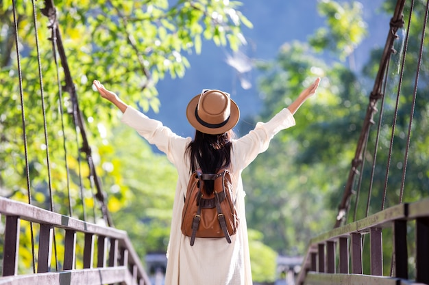 Female tourists spread their arms and held their wings Free Photo