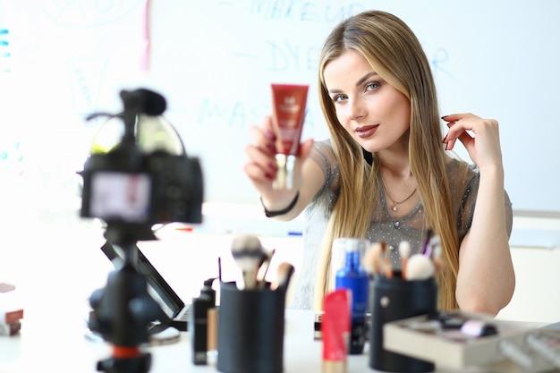 Female video blogger present brandnew cosmetics. blogging business ...
