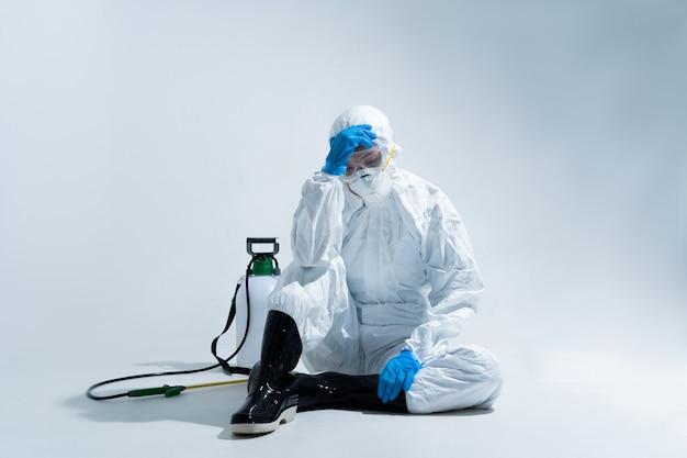 Female virologist, wearing ppe. she is feeling hopeless and tired. Premium Photo