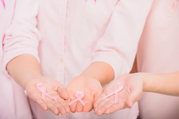 Female volunteers supporting breast cancer awarenes. Premium Photo