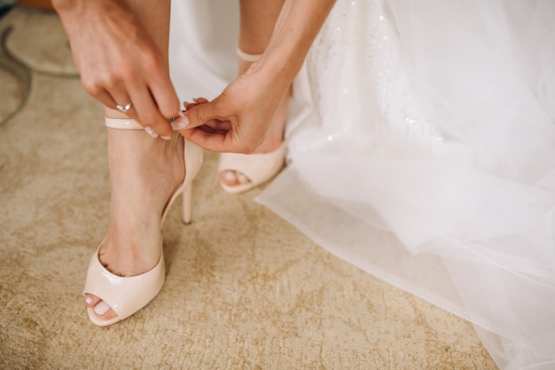 Female wedding shoes close up Free Photo