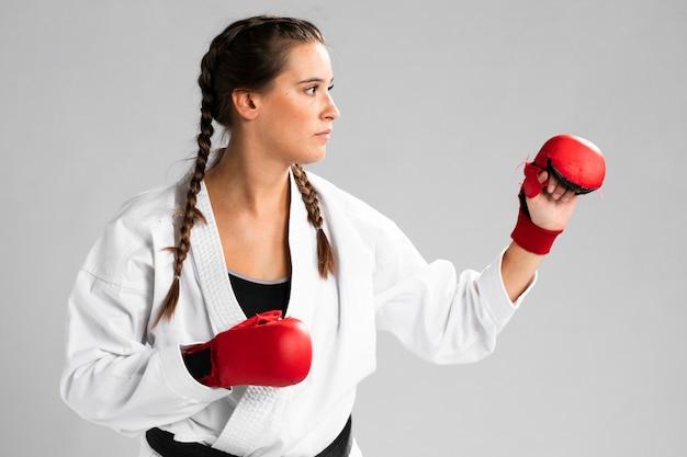Female with box gloves on white background Free Photo