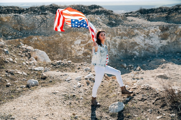 Female with usa flag looking at camera Free Photo