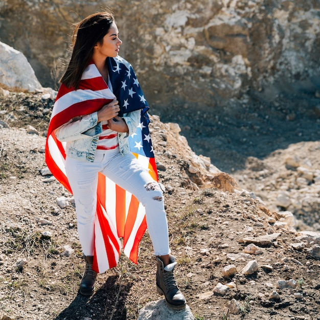 Female wrapped in flag standing on mountain Free Photo