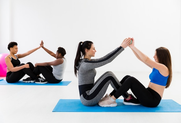 Females team work at fitness class Free Photo