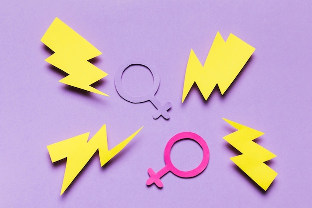 Feminine and masculine gender signs surrounded by thunders Free Photo