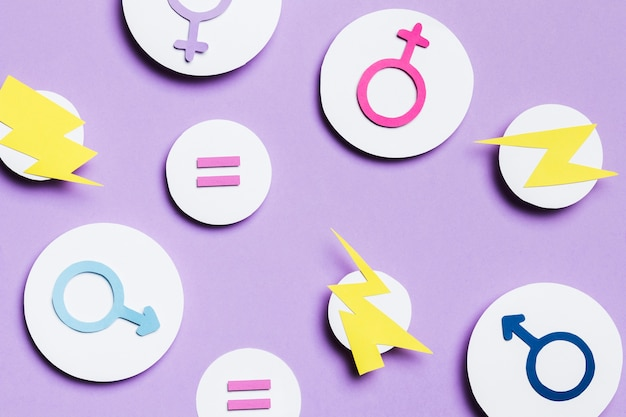 Feminine and masculine gender signs and thunders in bubbles Free Photo