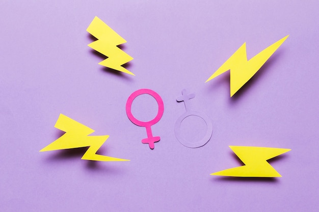 Feminine and masculine gender signs with thunders Free Photo