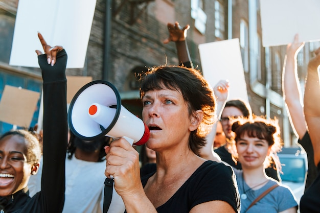 Feminist with a megaphone at a protest Premium Photo