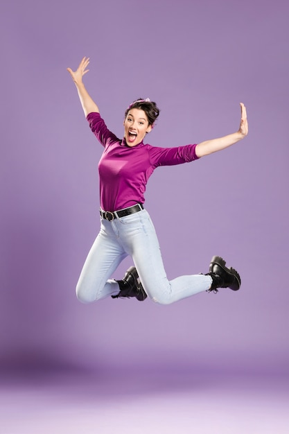 Feminist woman jumping and stretching her arms Free Photo