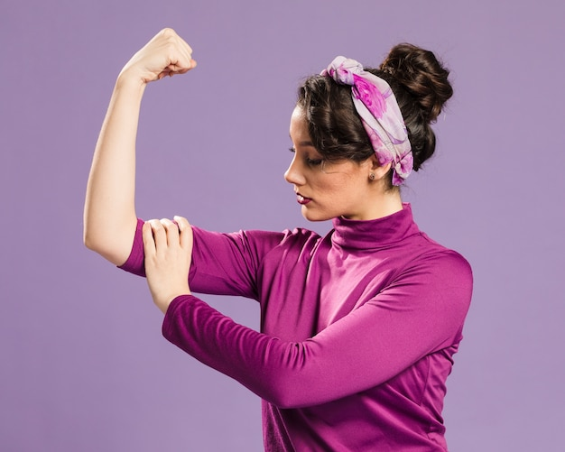 Feminist woman showing her power medium shot Free Photo