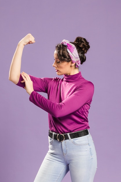 Feminist woman showing her power Free Photo