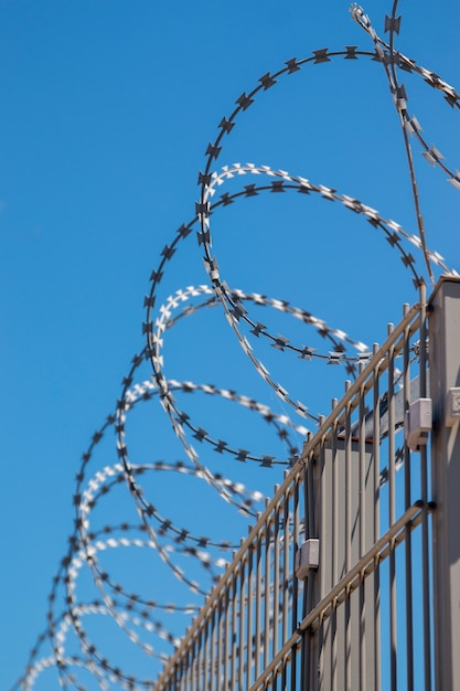 Fence with barb wire Premium Photo