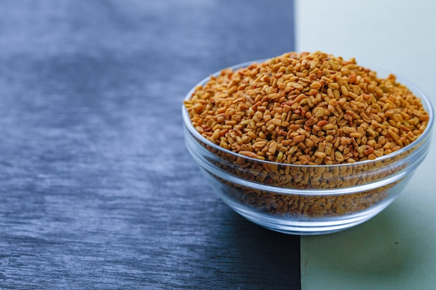 Fenugreek seeds in glass bowl Premium Photo