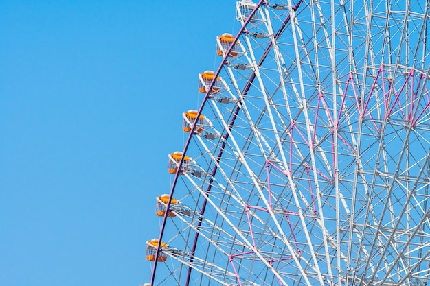 Ferris wheel in amusement park Free Photo