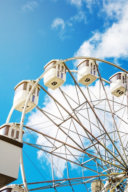 Ferris wheel on the background of blue sky Premium Photo