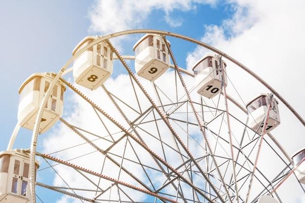 Ferris wheel on a background of blue sky Premium Photo