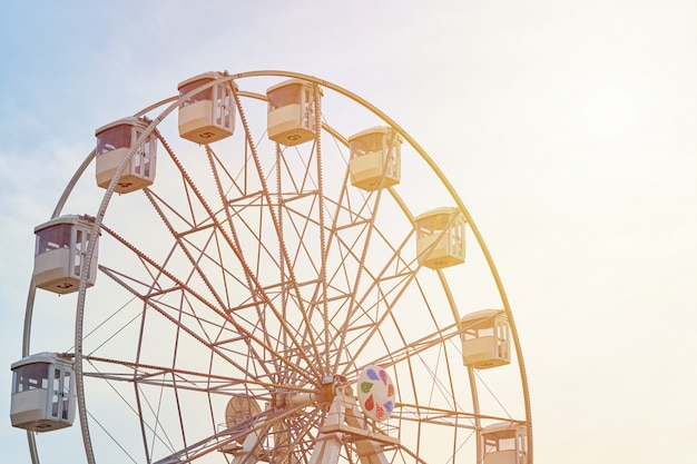 Ferris wheel carousel over sky with sunlight Premium Photo