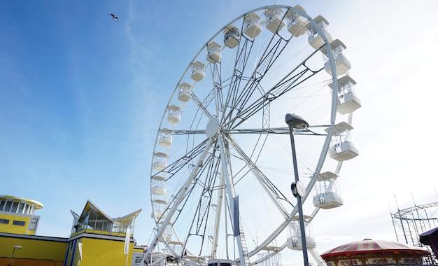 Ferris wheel at a theme park Free Photo