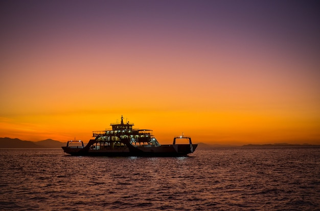 Ferry with sunset in puntarenas costa rica. Premium Photo