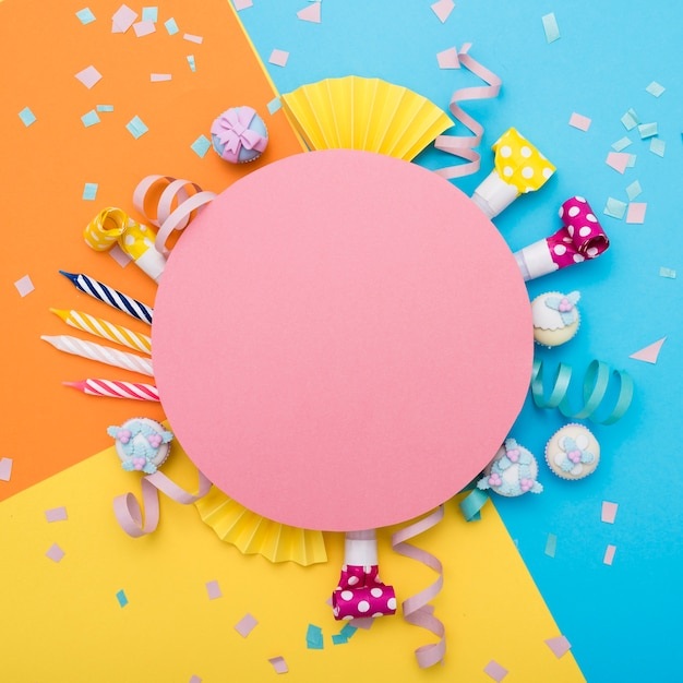 Festive colorful composition with blank round carton Free Photo