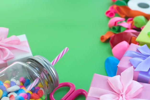 Festive composition set of gift boxes with balls candy cocktail materials. Premium Photo