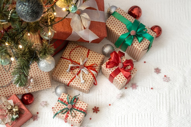 Festive cozy atmosphere, new year gift background top view. Free Photo