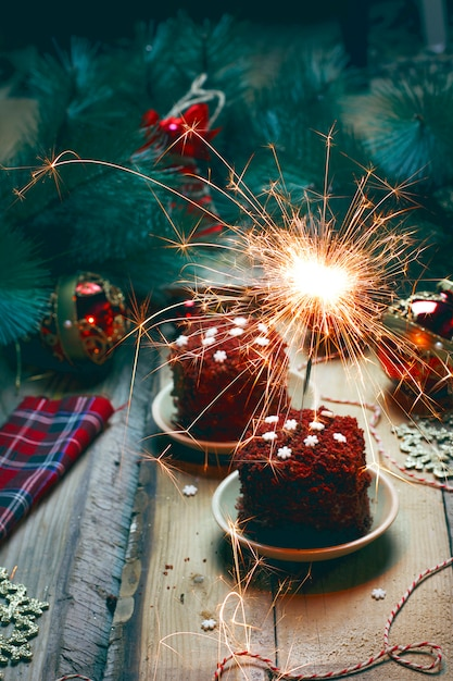 Festive dessert birthday or valentine dayred velvet cake with fireworks Free Photo