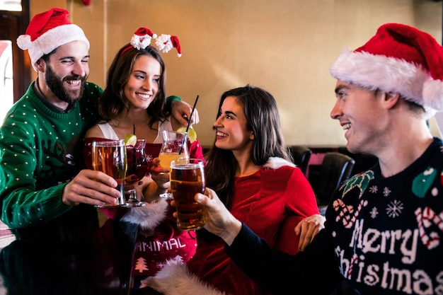 Festive friends drinking beer and cocktail Premium Photo