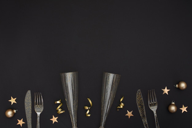 Festive glasses and cutlery with copy space Free Photo