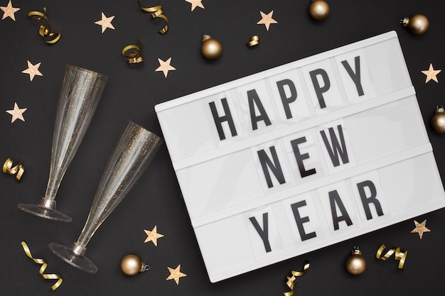 Festive glasses with happy new year sign Free Photo