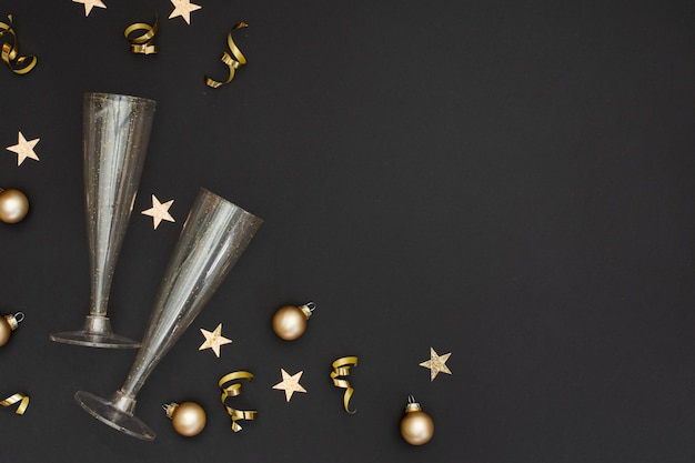 Festive glasses with party ornaments and copy space Free Photo