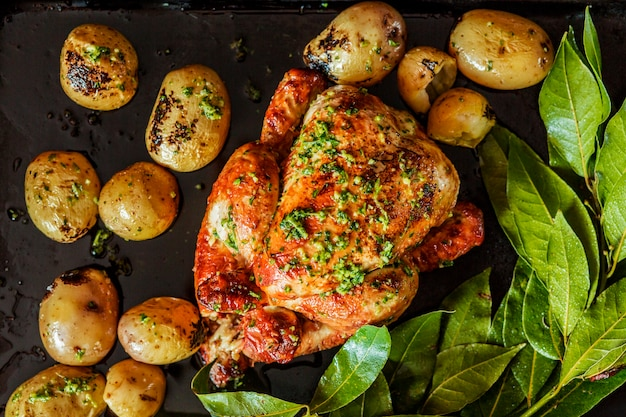 Festive grilled turkey with potatoes and herbs Free Photo