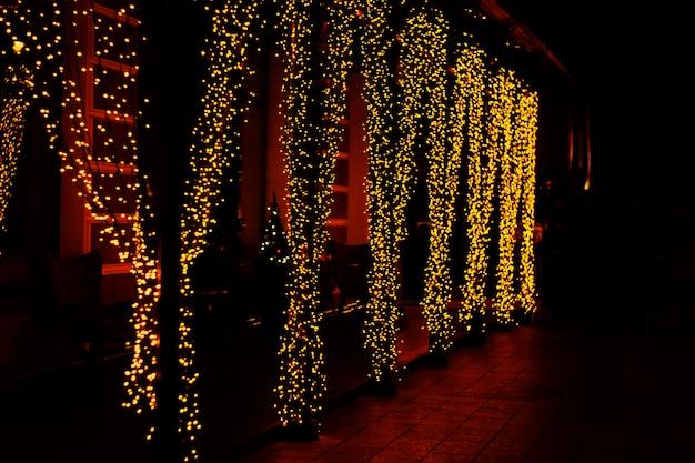 Festive street lighting garland curtain in yellow color Premium Photo