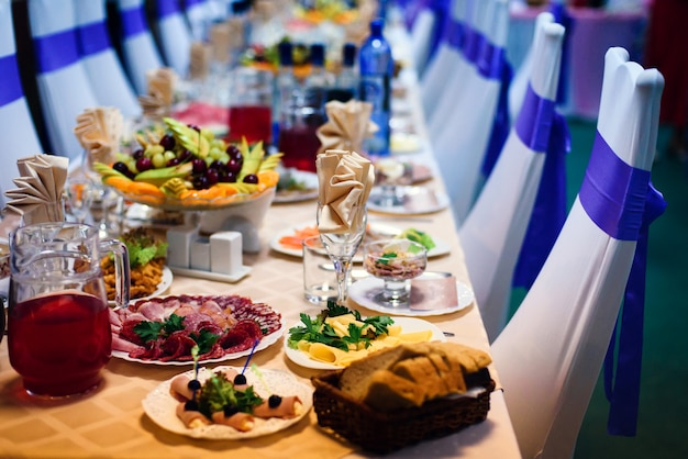 Festive table in the restaurant with plates, glasses and cutlery on a white tablecloth Premium Photo