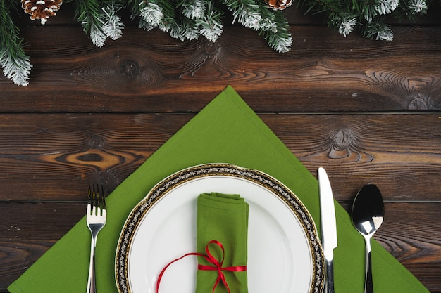 Festive table setting for christmas dinner, top view Premium Photo