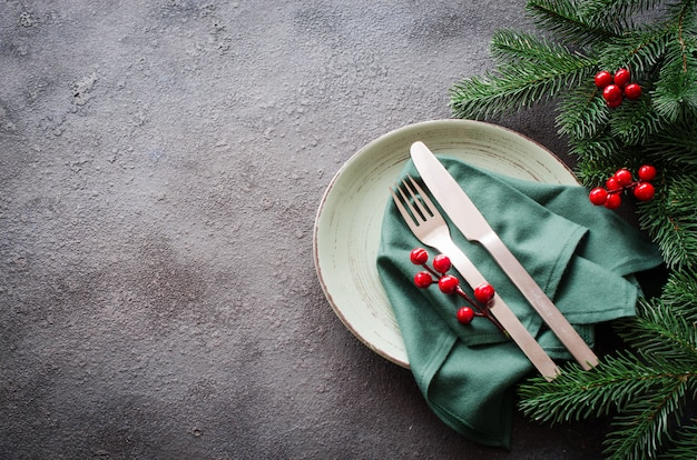 Festive table setting for christmas or new year dinner. Premium Photo