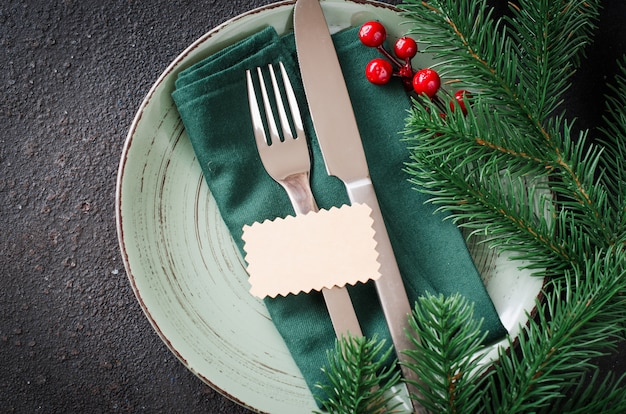 Festive table setting for christmas or new year dinner Premium Photo