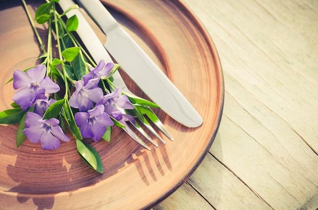 Festive table setting with purple flowers. Premium Photo