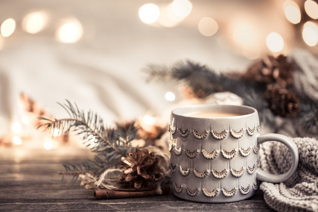 Festive wall with cup on wooden wall with lights. Free Photo